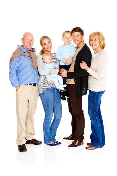 Familia extendida de pie juntos Aislado en blanco - foto de stock