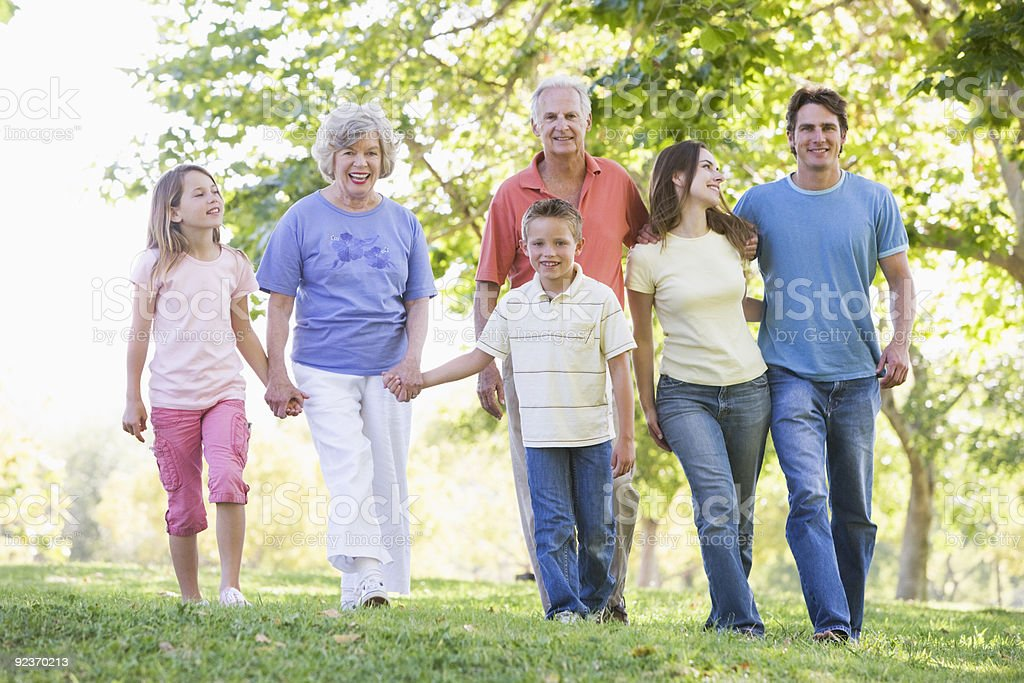 Extended family walking in park royalty-free stock photo