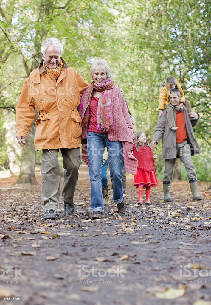 Extended family walking outdoors in autumn 免版稅 stock photo