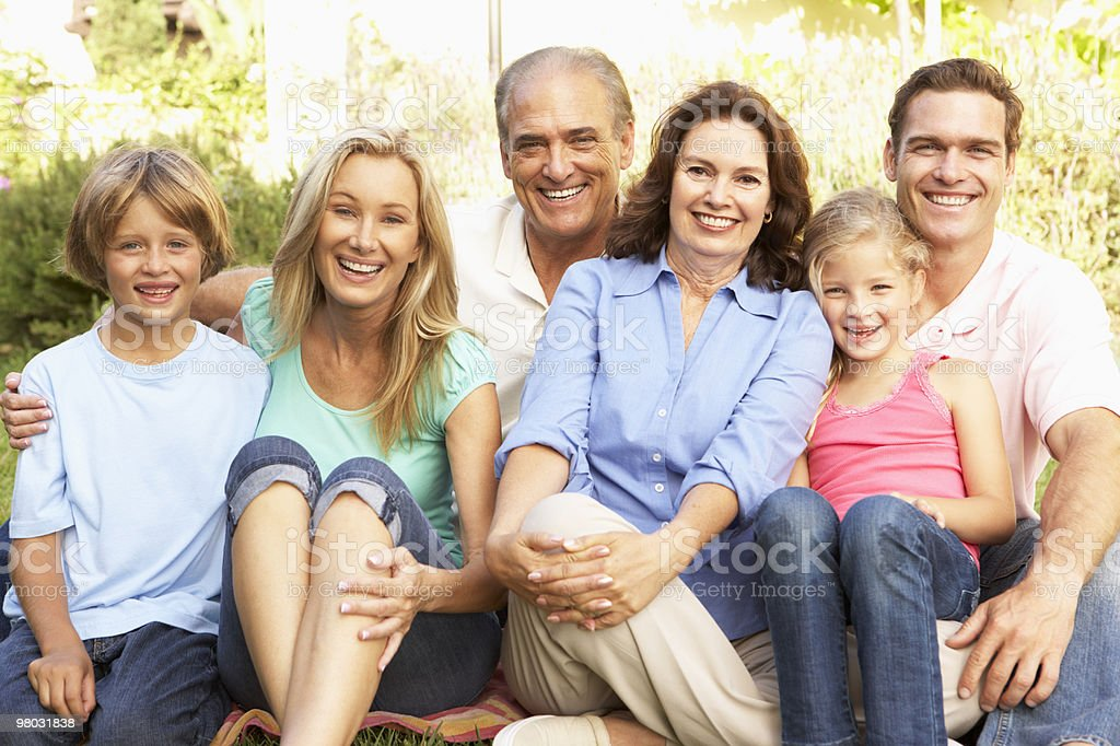 Extended Group Portrait Of Family In Garden royalty-free stock photo