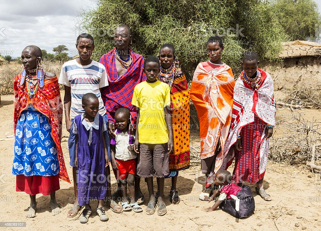 Extended Maasai family outside the village. stock photo