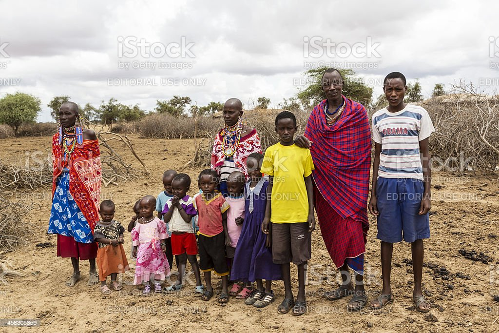 Extended maasi family outside village stock photo