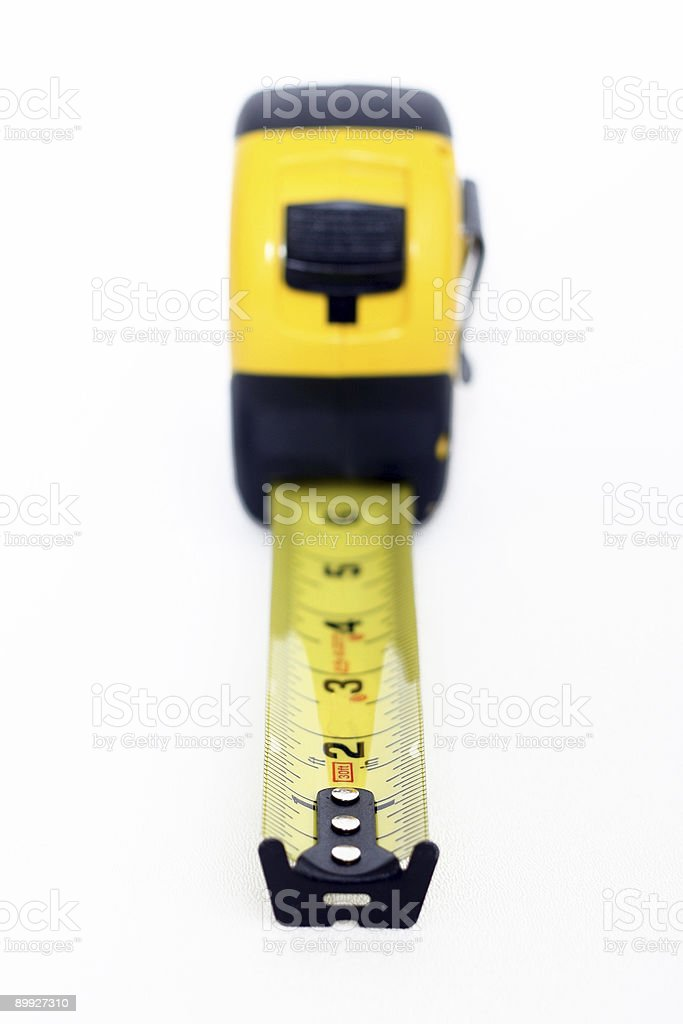 Extended Measuring Tape on White Background - Close-Up stock photo
