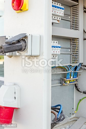 istock Extension cord is plugged in the socket of fuse box 607980802