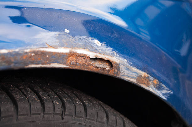 Extensive rust damage on car stock photo