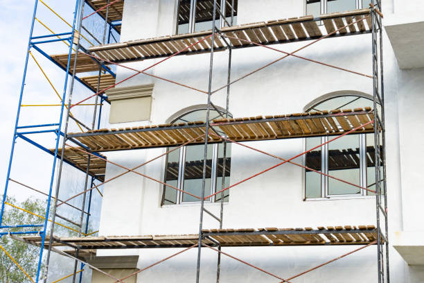 Extensive scaffolding for building a new house. Constraction of platforms for building works stock photo