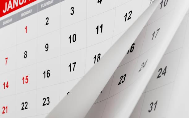 extereme fermer vers le haut des pages d'un calendrier de pliage - calendrier digital journée photos et images de collection