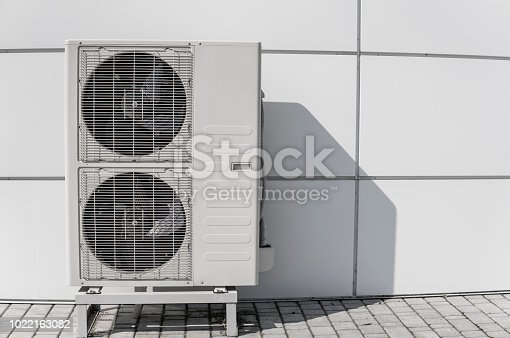 939450782 istock photo Exterior air conditioning unit on a wall. 1022163082