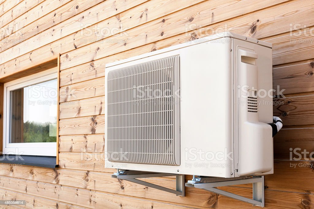 Exterior airconditioning unit on a wooden wall stock photo