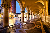 Exterior corridor of Doge's Palace at night in Venice, Italy