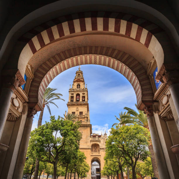 Exterior courtyard of the Mezquita in Cordoba, Spain. View through an archway onto the exterior courtyard of the Mezquita in Cordoba, Spain. The former mosque was converted by the catholics into a cathedral. This outdoor area is open to the public and freely accessible. cordoba mosque stock pictures, royalty-free photos & images