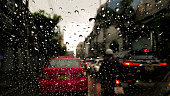 Exterior image of the car mirror during the rain while the traffic jam