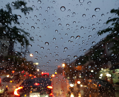 Exterior image of the windshield while it rains.Traffic jam