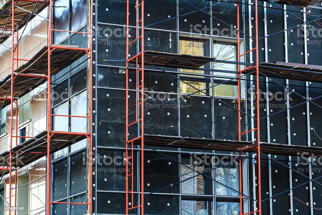 Exterior insulation of building wall under construction stock photo