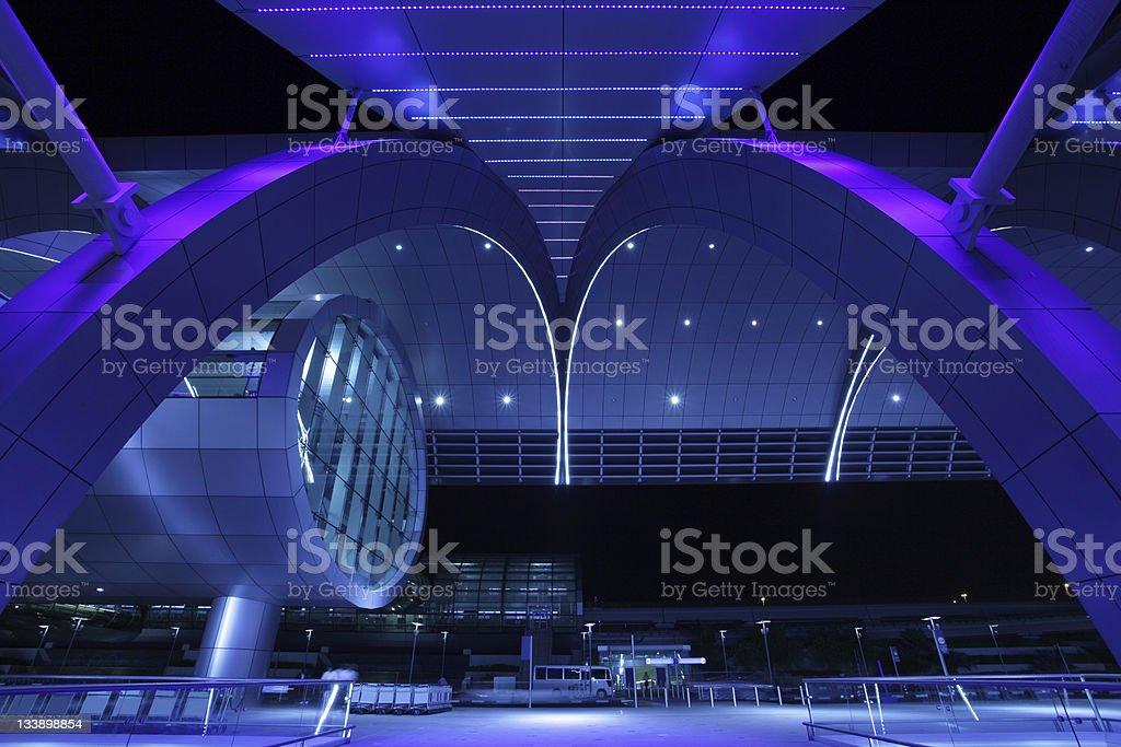 Exterior night shot of Dubai International Airport New terminal of the Dubai International Airport illuminated at night. United Arab Emirates Airport Stock Photo