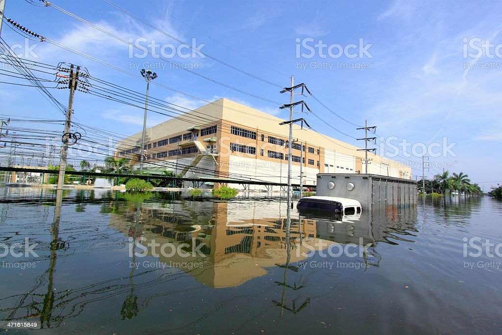 Exterior of a building and street under heavy flooding stock photo