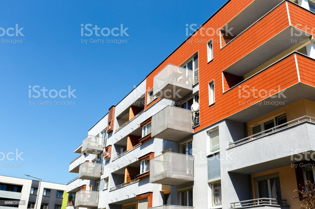 Exterior of a modern apartment buildings on a blue sky background. No...