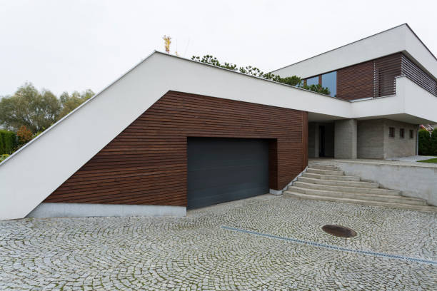 Exterior of a modern house Exterior of a modern house with functional garage war effort stock pictures, royalty-free photos & images