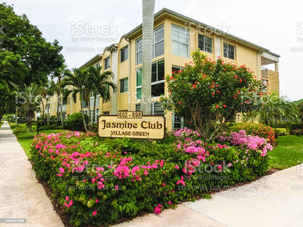 Exterior of a two-story modern resort building Jusmine club at Green...