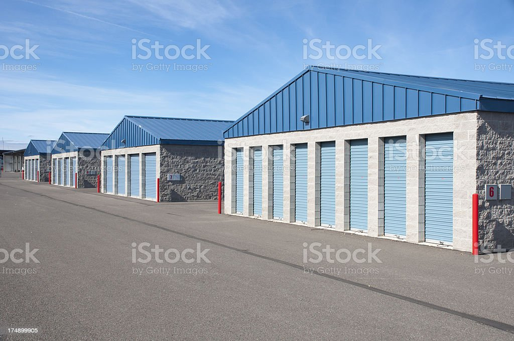Exterior of blue and tan storage units stock photo
