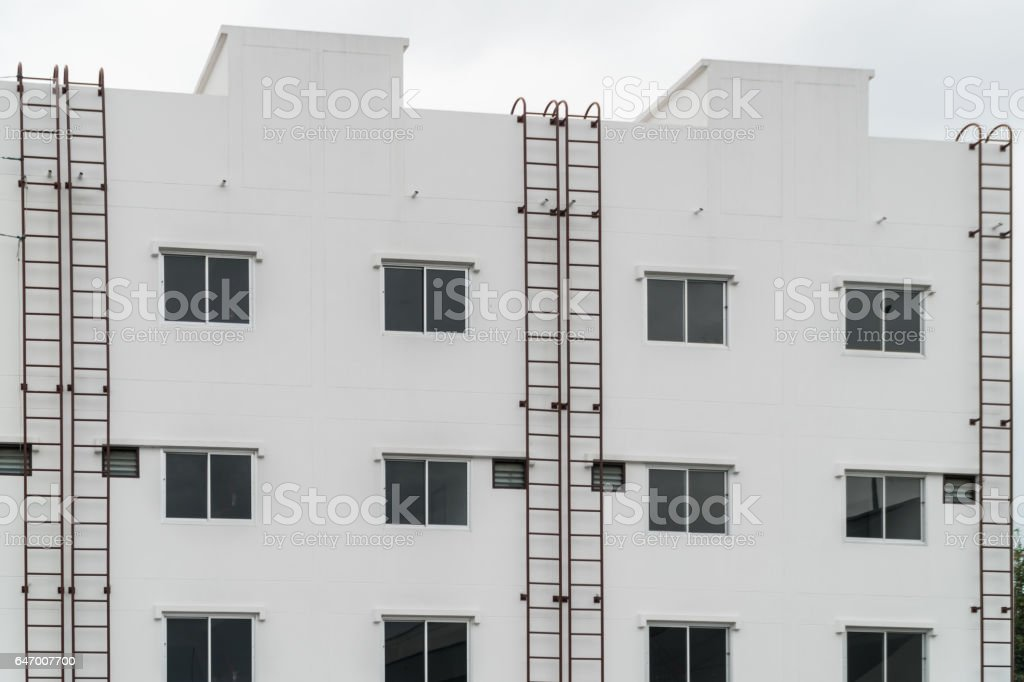 exterior of building with the fire escape.blue sky background stock photo