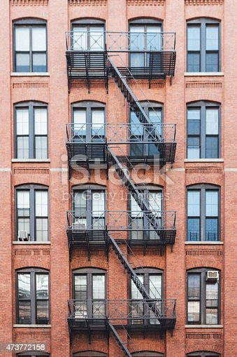 window, fire escape and old apartment. Exterior of buildings in New York City.