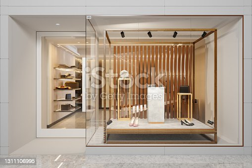 istock Exterior Of Clothing Store With Shoes And Other Accessories Displaying In Showcase 1311106995
