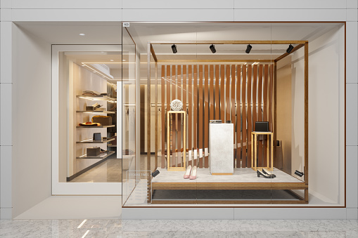 Exterior Of Clothing Store With Shoes And Other Accessories Displaying In Showcase