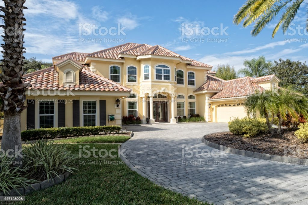 Exterior of Estate Home with Paver Driveway stock photo