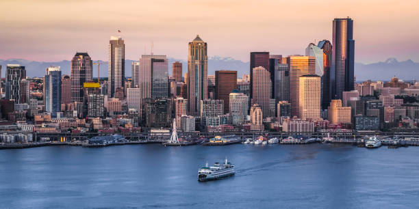 Exterior of modern cityscape View of crowded modern cityscape with 1201 Third Avenue, U.S. Bank Centre, ship moving in foreground, Seattle, Washington, United States. promenade stock pictures, royalty-free photos & images