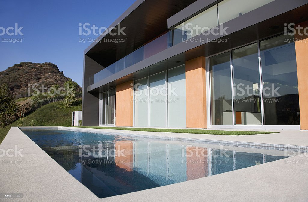 Exterior of modern house and swimming pool stock photo