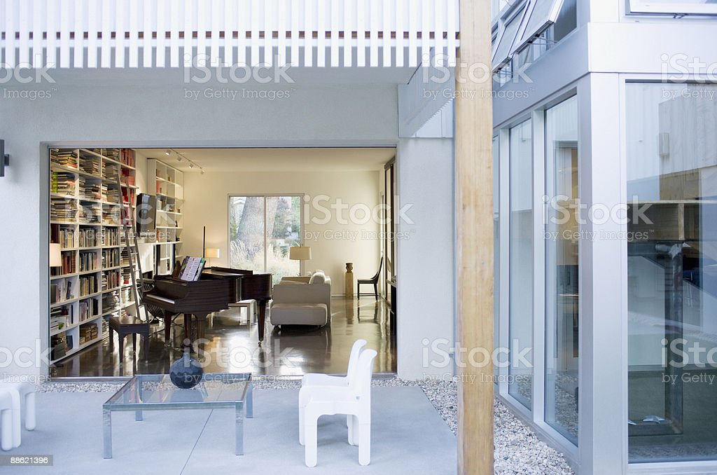 Exterior of modern house, patio and glass walls royalty-free stock photo