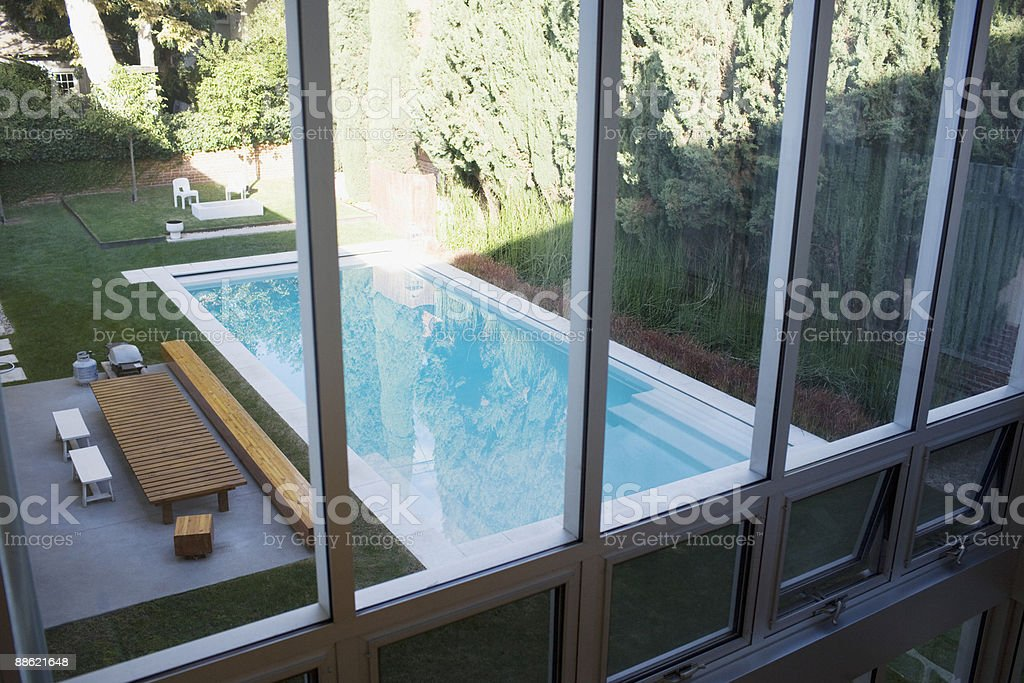 Exterior of modern house, swimming pool and patio