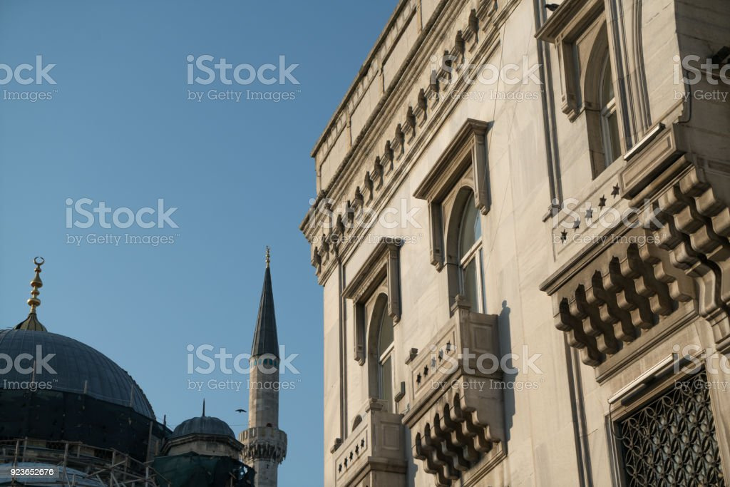 Exterior of Mosque and Bulding in Sunny Day stock photo