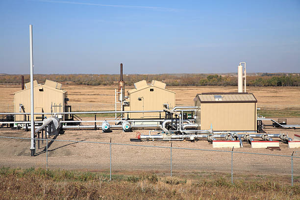 Exterior Of Oil And Gas Industry Compressosr Station Working in harmony with agriculture the transmission of gas from the field enters here to be disbursed. compressor stock pictures, royalty-free photos & images