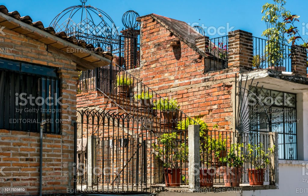 Gated garden and terrace with ornate wrought ironin old town. MX