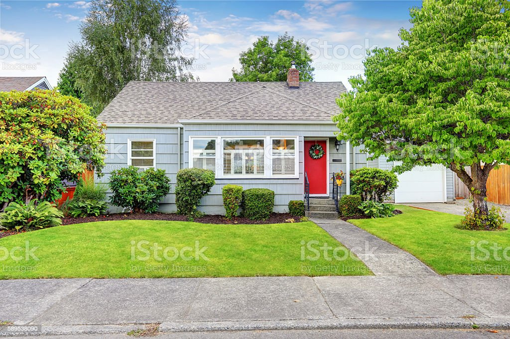 Exterior of small American house with blue paint