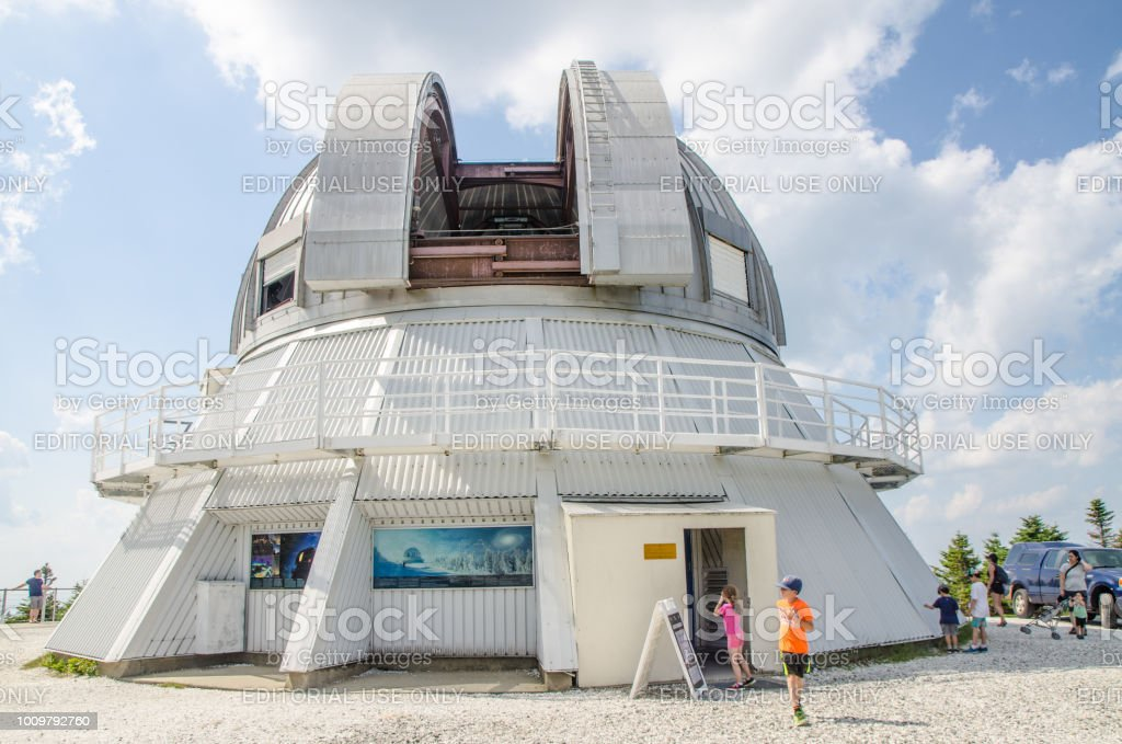 Exterior of the astral observatory of Lac Megantic with people around during day of summer stock photo