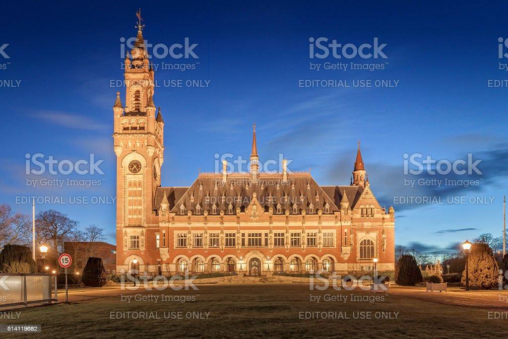exterior of The Hague's illuminated Peace Palace stock photo