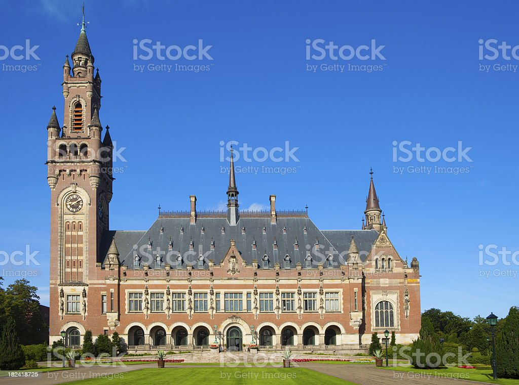 exterior of The Hague's Peace Palace against a blue sky royalty-free stock photo