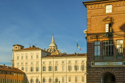 Exterior of the Royal Armory and the Royal Palace (Italian: Armeria Reale e Palazzo Reale) in Piazza Castello square in the historic of Turin in a sunny day, Piedmont, Italy