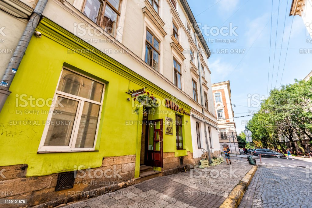 Exterior Of Yellow Green Restaurant Cafe Buildings In Historic Ukrainian Polish City Stock Photo Download Image Now Istock