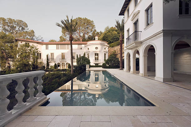 exterior photo of a bel air mansion featuring a pool - stately home stock photos and pictures