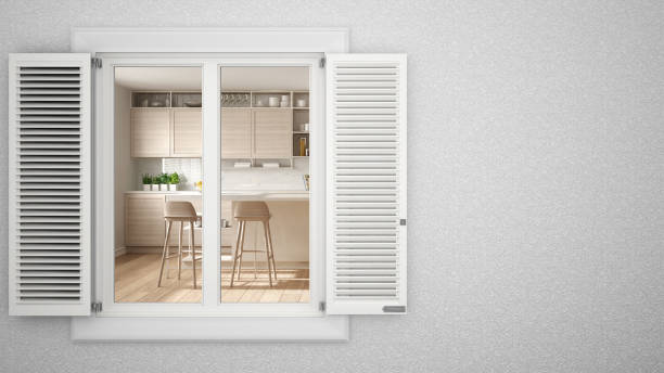 Exterior plaster wall with white window with shutters, showing interior modern kitchen, blank background with copy space, architecture design concept idea, mockup template stock photo