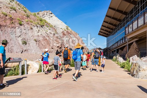 Jensen, USA - July 23, 2019: Exterior Quarry visitor center exhibit hall in Dinosaur National Monument Park with people tour group walking in Utah