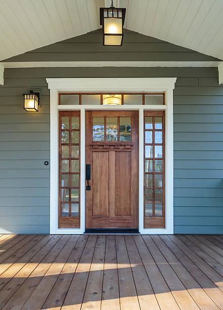 exterior shot of a wooden front door on upscale home - fasad bildbanksfoton och bilder