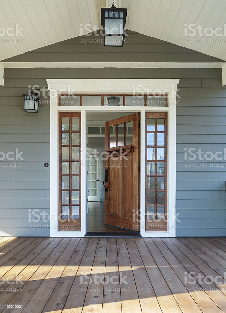Exterior shot of an open Wooden Front Door stock photo