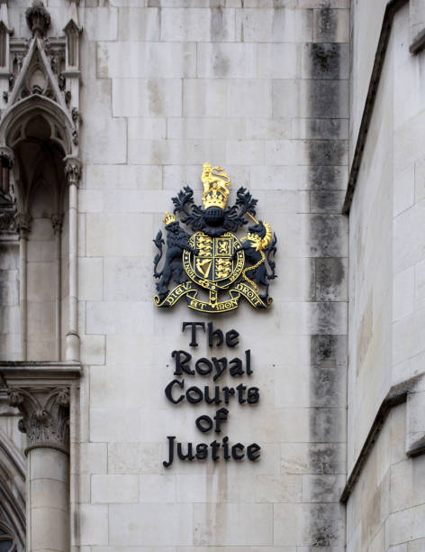 Exterior sign outside the Royal Courts of Justice on The Strand, in London. stock photo
