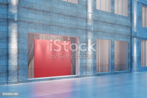 istock Exterior storefront with blank red billboard at night, mock up, 520592492