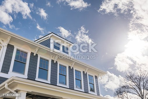 istock Exterior view of a house with lots of windows 1130206991